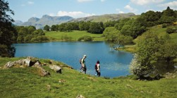 Walking at Loughrigg Tarn